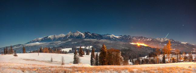 Panoramic mountains landscape at winter night in Tatra