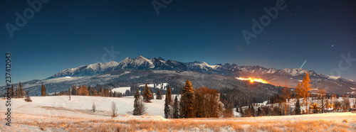 Foto auf Leinwand Blaue Nacht Panoramic mountains landscape at winter night in Tatra