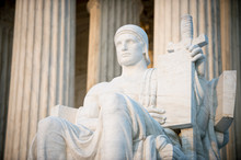 Authority Of Law Statue At The Neoclassical Columned Entrance To The US Supreme Court Building In Washington DC
