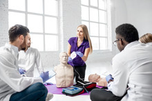 Group Of Young Medics With Ins...