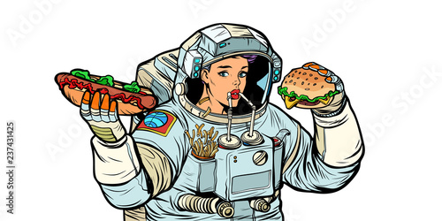 Woman astronaut eats. Cola, hot dog and Burger fast food. Isolat Canvas-taulu