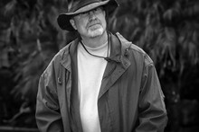Portrait Of A Older Man In Hat Outdoors