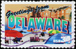 Greetings from Delaware postcard on postage stamp