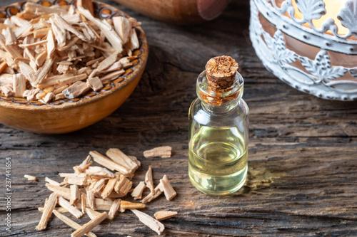 Valokuva  A bottle of cedar essential oil with cedar wood