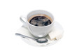 Cup of black coffee on a saucer with a napkin, a teaspoon and lumps of sugar