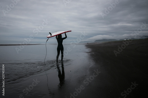 Surfing on the black volcanic beach of the Pacific Ocean, Kamchatka, Russia, the Far East Wallpaper Mural