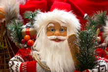 Smiling Santa Claus With Gifts And New Year's Tree Close Up. Merry Christmas And Happy New Year Concept. Winter Holidays Background. Miracle And Happiness Concept. Cheerful Greeting. Xmas Decoration.