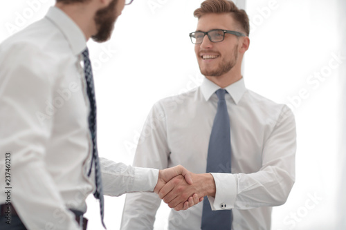 Staande foto Hoogte schaal close up.business handshake of business people on a light background
