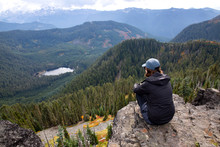 Woman Hiker Sitting On Cliff E...