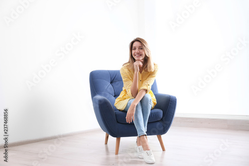 Cuadros en Lienzo  Young woman sitting in armchair at home