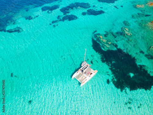 Leinwand Poster Drone aerial view of catamaran sailing boat in Maddalena Archipelago, Sardinia, Italy