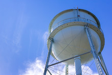 White Water Tower In Blue Sky With Copy Space