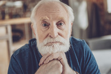 Portrait Of Serious Grandfather That Looking At You