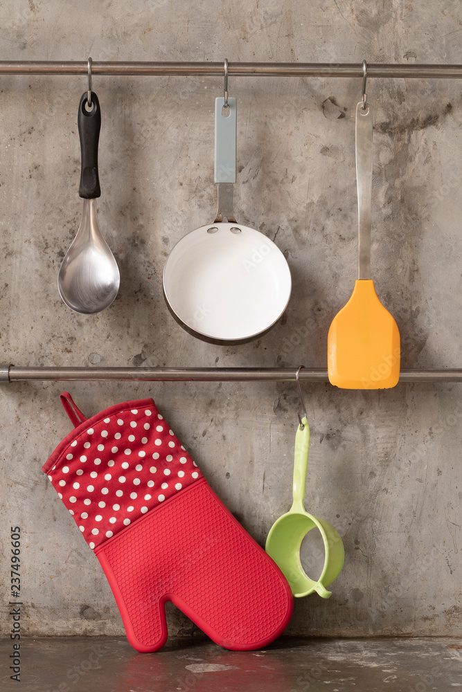 Photo Art Print Kitchenware Hanging On Stainless Rail On Cement