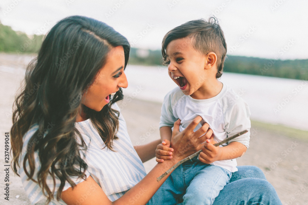 Fototapeta An indian mother and her son laughing together.