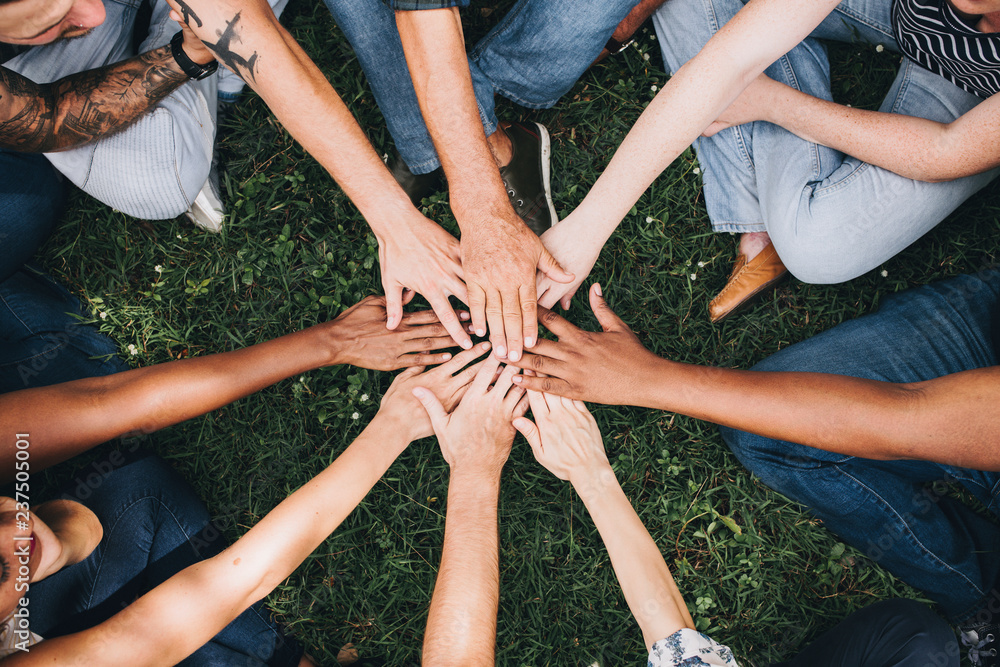 Fototapety, obrazy: People stacking hands together in the park