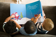 Young Kids Reading A Christmas Story Together