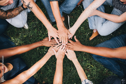 People stacking hands together in the park Canvas Print