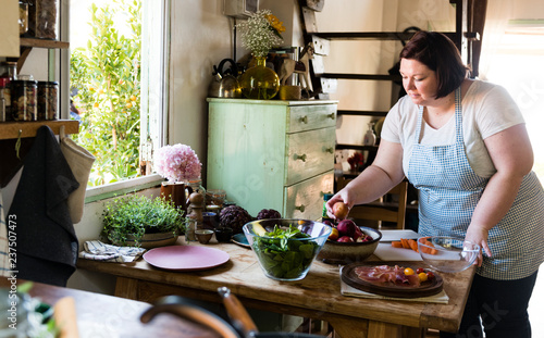 Woman preparing dinner in the kitchen