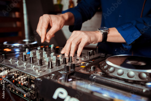 Fotografie, Obraz  DJ Spinning, Mixing, and Scratching in a Night Club, Hands of dj tweak various t