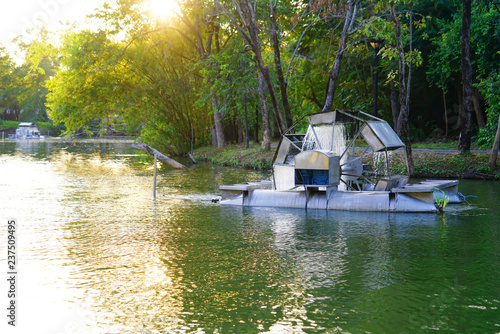 Chaipattana low speed surface aerator, turbine baler or waterwheel mechanical aerator and water treatment at park in Thailand Canvas Print