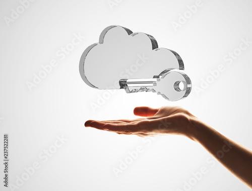 Staande foto Hoogte schaal Cloud computing concept with glass symbol shown in hand