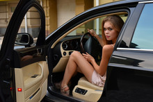Beautiful Girl In A Rich Car
