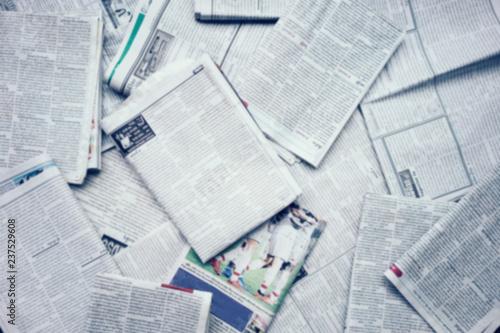 Fényképezés  Lots of old newspapers background.