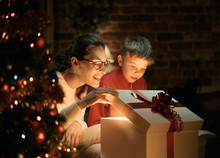 Boy And His Mother Opening Christmas Gifts