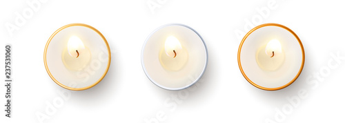 Obraz na plátně Set of top view burning candles isolated on white background.