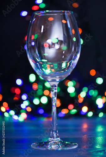 Cocktail ideas concept. Easy recipes for winter alcoholic cocktail drinks. Cocktail glass on defocused garland colorful lights. What to drink on christmas party. Alcohol cocktail for winter party