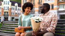 Beautiful Young Woman Meeting Boyfriend On First Date, Man Presenting Flowers