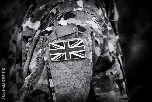 Photo  Flag of United Kingdom on soldiers arm