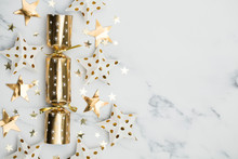 Christmas Crackers. Luxury Gold Festive Cracker On A Marble Background