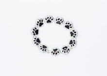 Metal Bracelet Made With Black And Silver Dog Paws