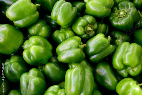 Fotografie, Obraz Fresh picked raw green bell peppers, farmers produce market, Rajasthan, India
