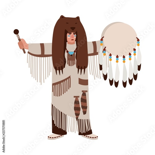 Photo American Indian wearing bearskin and ethnic clothes beating his drum and calling spirits