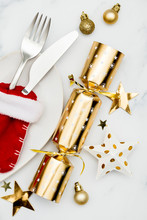 Christmas Meal Flay Lay. Festive Table Setting With Cracker And Stocking