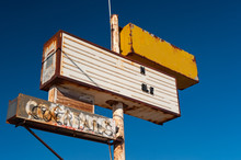 Old Rusty Abandoned Motel Sign In The Desert Outside Of Los Angeles, California
