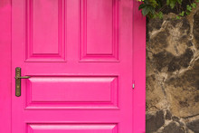 Vintage Wooden Pink Door With Metal Furniture