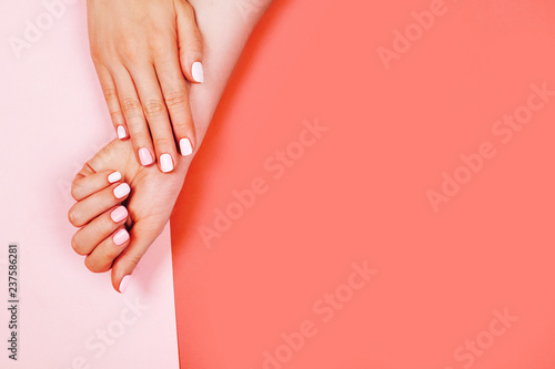 Aluminium Prints Manicure Stylish trendy female manicure. Beautiful young woman's hands on Living Coral background. Color of the year 2019 concept.