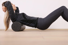 Woman Doing Balance Foam Roller Exercises. Mindful Workout Holistic Health Care.