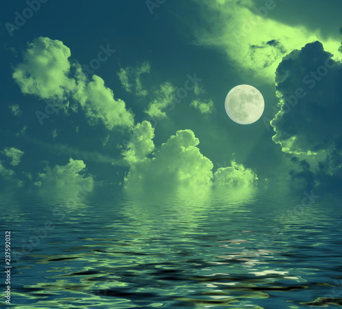 Valokuva night lunar landscape full moon reflected in water night clouds