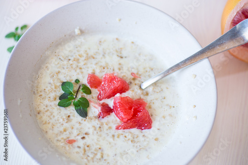 Wall Murals Flower shop sweet oatmeal with slices of red grapefruit in a ceramic bowl