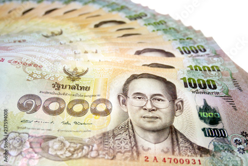 One thousand baht banknotes put on the isolated white background
