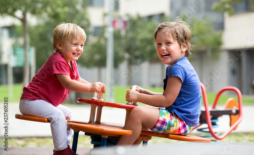 Foto  Children having fun at playground