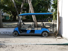 Blue Golf Cart On A Sandy Beac...