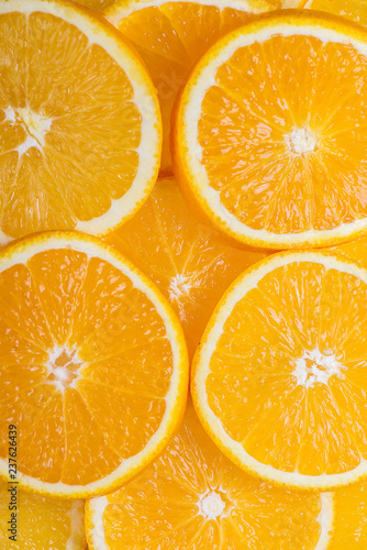 Photo Stands Slices of fruit Healthy food, background. Orange