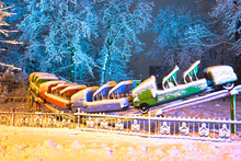 Snow-covered Attractions In The Old Park