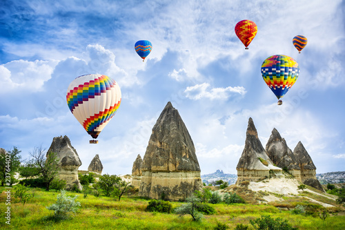 Poster Turquie The great tourist attraction of Cappadocia - balloon flight. Cappadocia is known around the world as one of the best places to fly with hot air balloons. Goreme, Cappadocia, Turkey